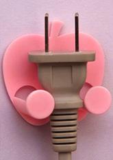 Тримач для штекерів вилок електроприладів